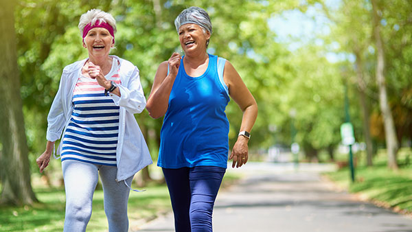 Shot of two elderly friends enjoying a run together outdoors