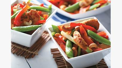 chicken and veggies in a white bowl