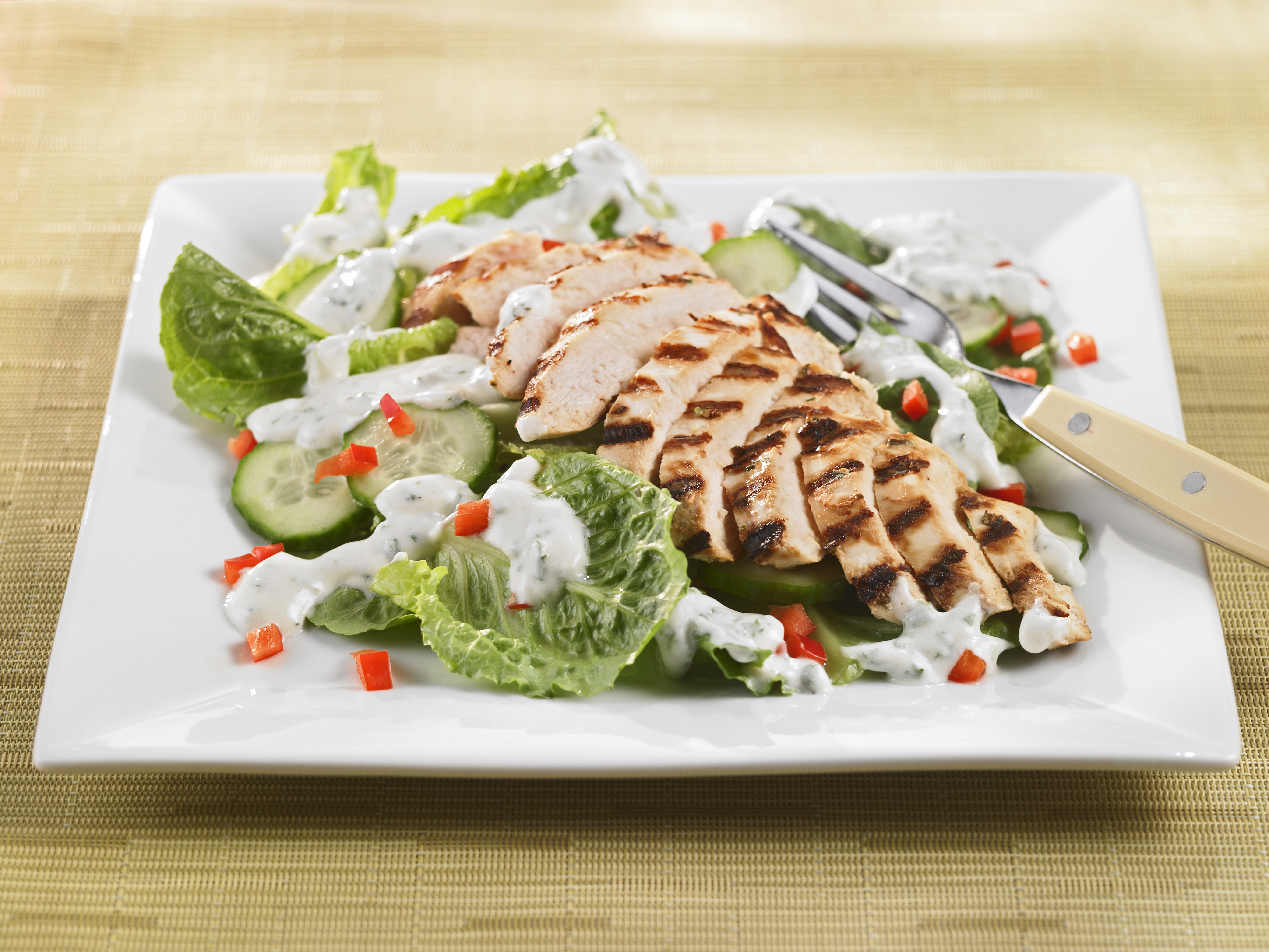 Chicken salad on a white plate