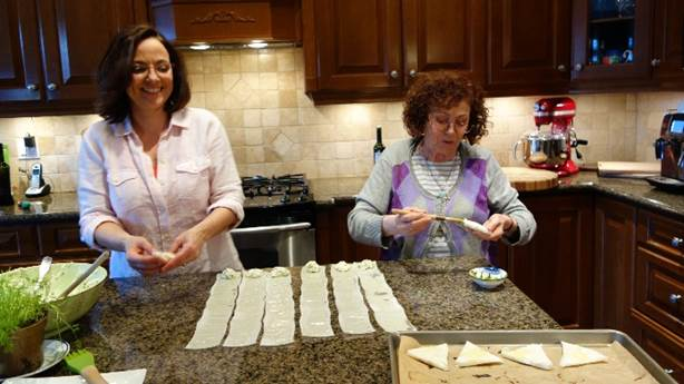 <p>Christine and her mother cooking together.</p>