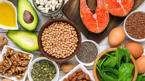 A top view of foods rich in omega-3 and other healthy fats displayed on a table.