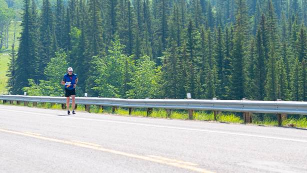 <p>Dr. Michael Hill runs along the highway in the Kananaskis Valley southwest of Calgary.&nbsp;&nbsp;</p>