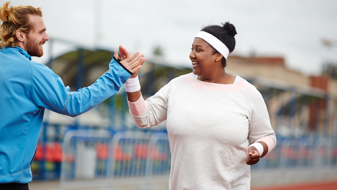 Woman giving her trainer a high five