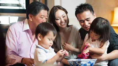 Asian family in lounge