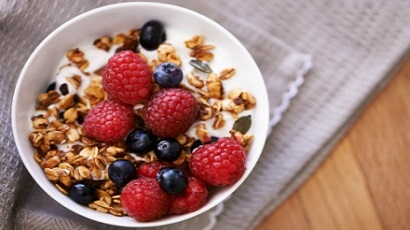 bowl of yogurt with fresh berries and granola