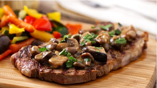Garlic herb steaks with sautéed mushrooms