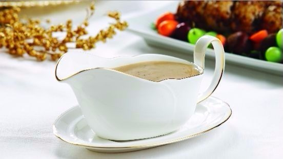 Porcini mushroom gravy in white gravy boat