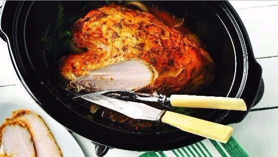 Roast turkey with dill in roasting pan