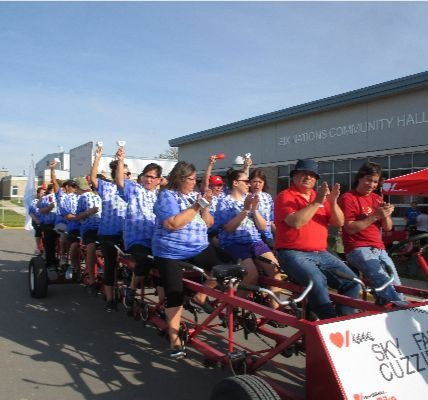 Members of the Sky family wear matching blue and white Tshirts as they ride the Heart  Stroke Big Bike