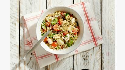 Bowl of bulgur, tomato, cucumber, Swiss cheese and chicken