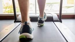 Close up of man's feet running on treadmill