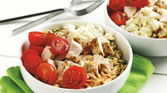 Chicken, tomatoes, feta and brown rice in a bowl