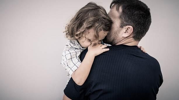 Dad hugging toddler