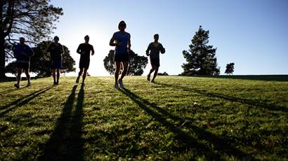 Five people jogging in park
