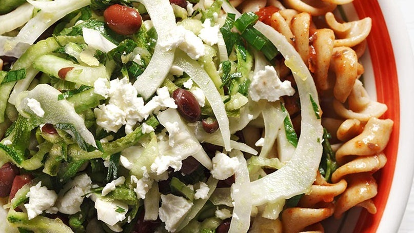 Fusilli pasta with shredded zucchini, fennel, feta and black beans