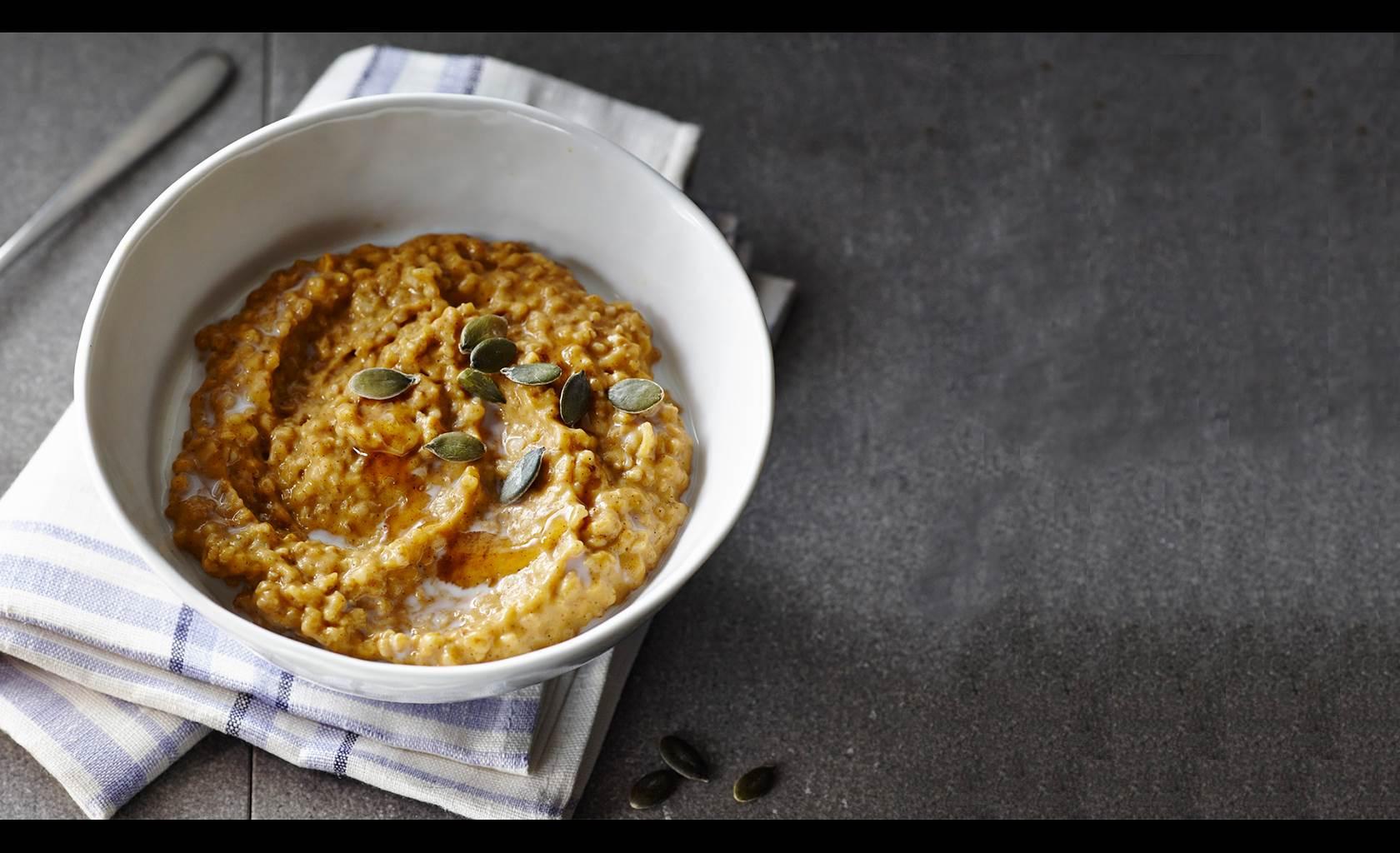 Bowl of pumpkin oatmeal with pumpkin seeds