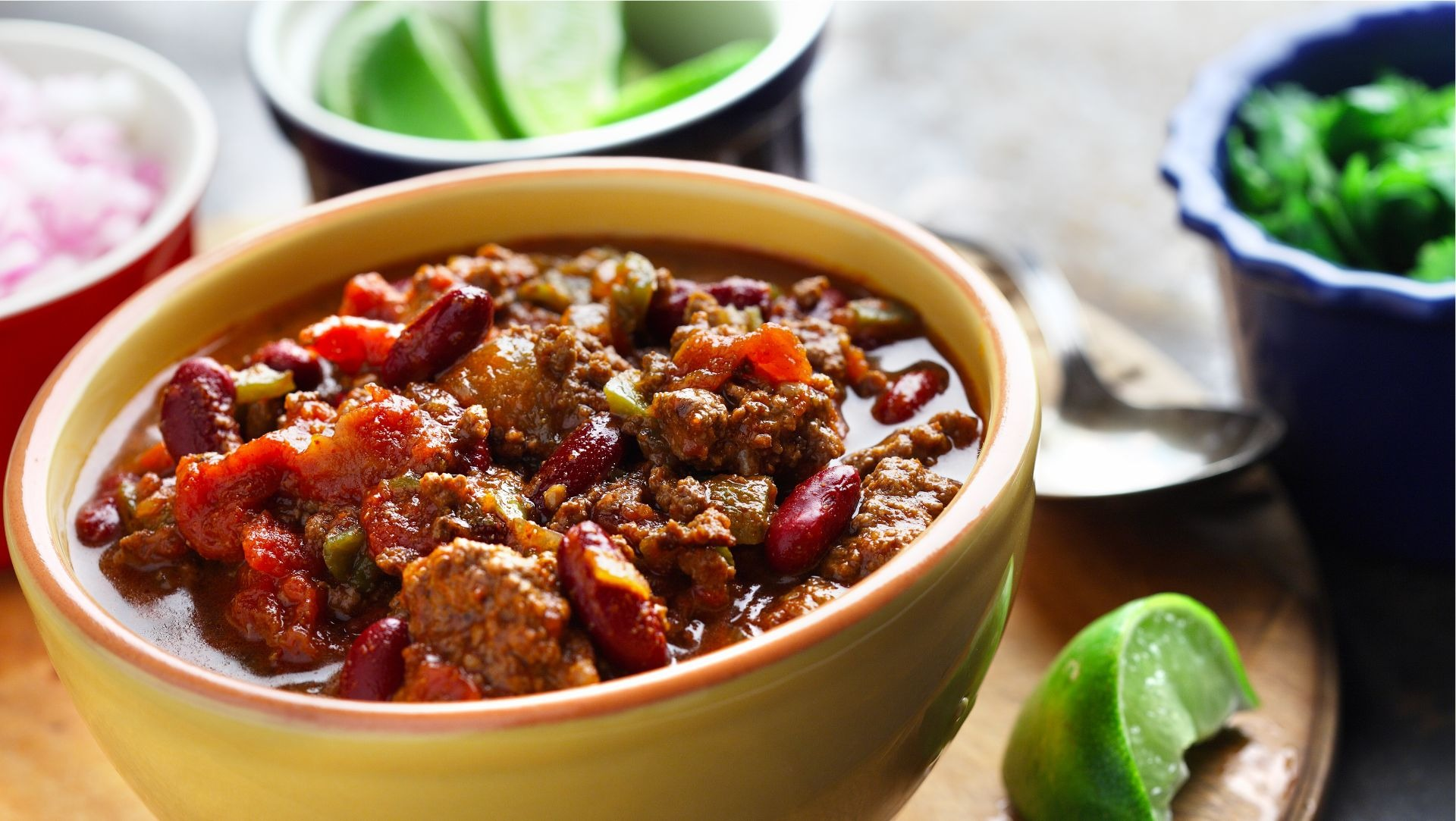 Bowl of chili ground beef, red peppers and beans