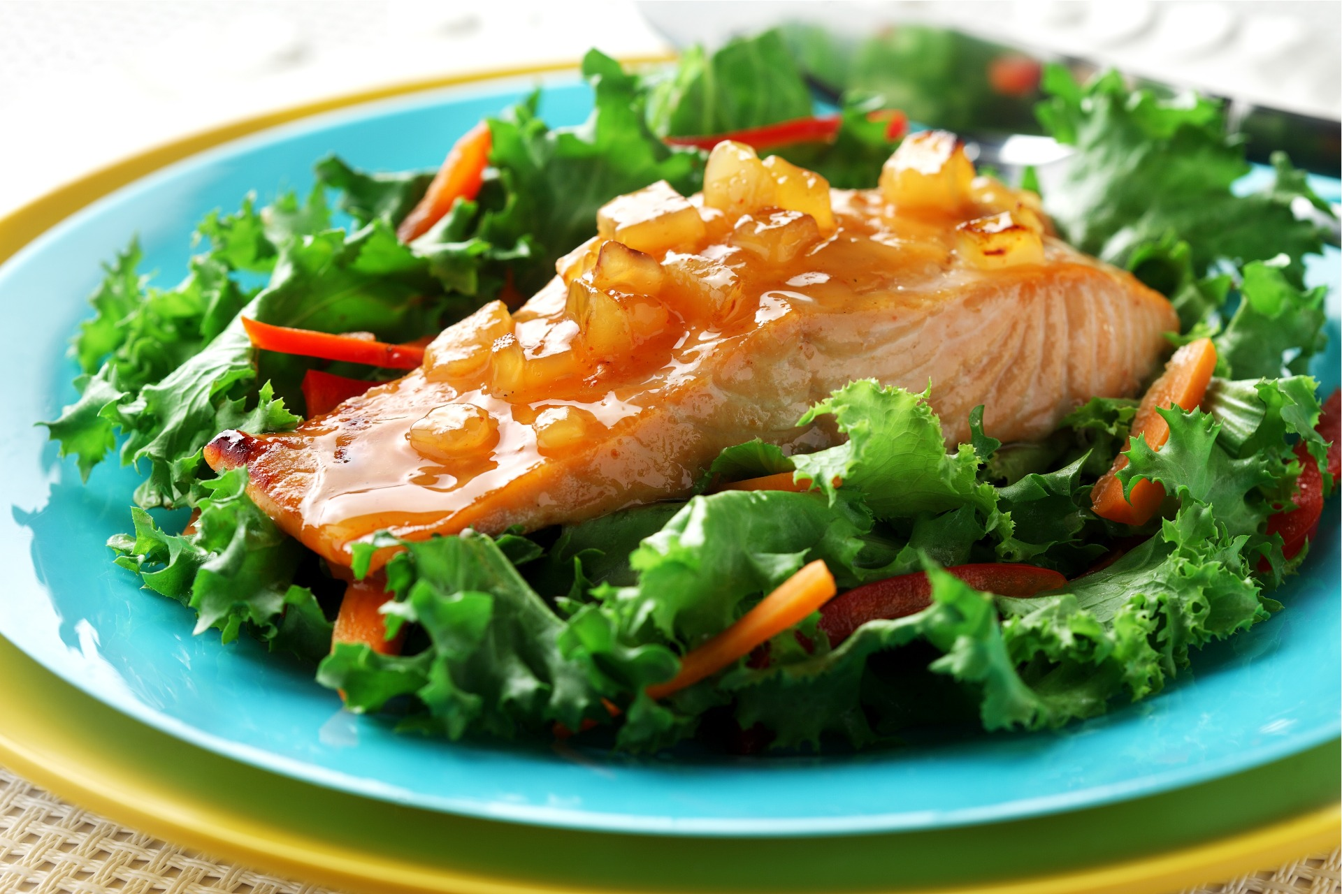 Salmon with mango chutney on bed of greens
