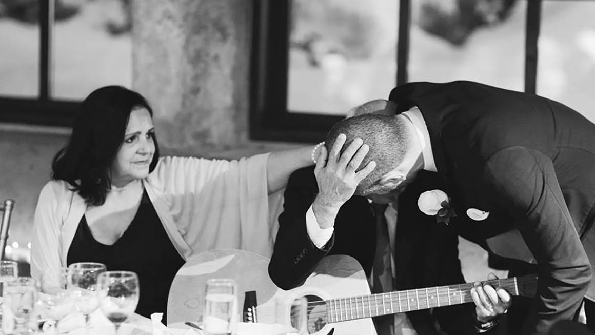 At this wedding, Regis gives his father Pedro an emotional hug after Pedro plays guitar and sings while recovering from a stroke.