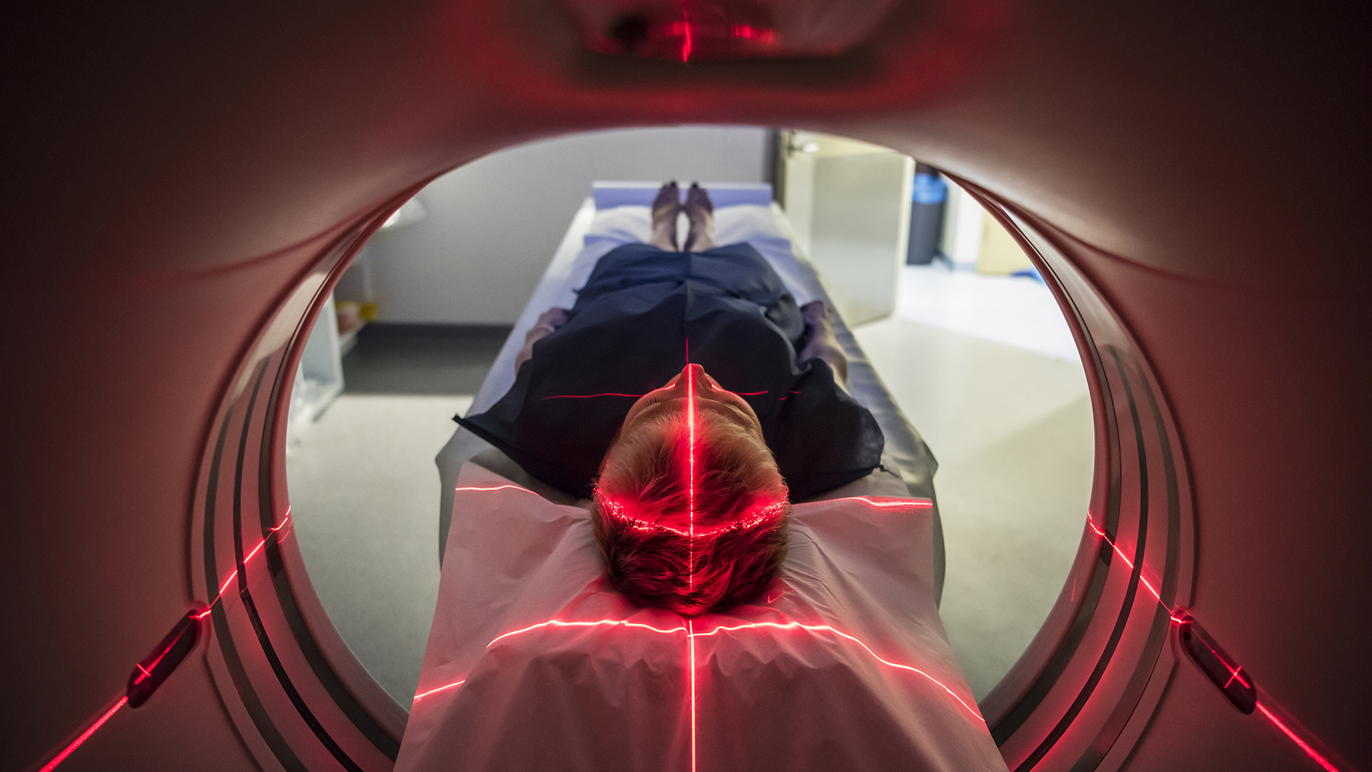 Person undergoing a CAT scan in hospital