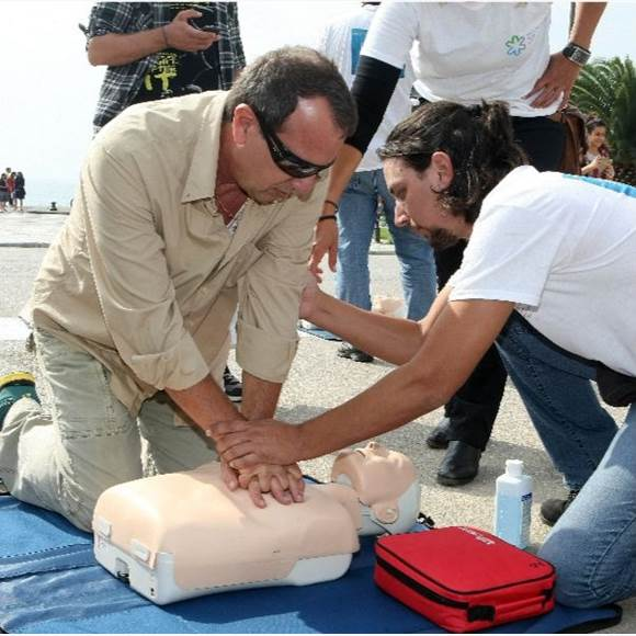 Man learning how to perform CPR