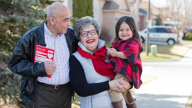 Grand parents with grandaughter canvassing for HeartStroke