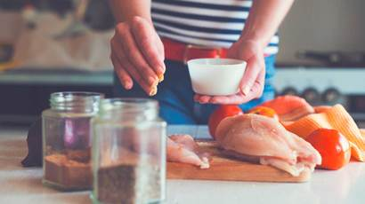 Woman making chicken dish
