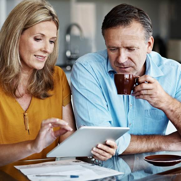 Couple looking at their finances on iPad