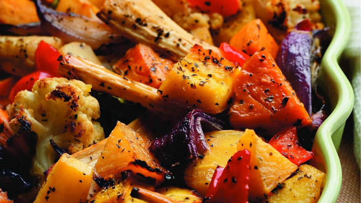 Maple roasted vegetables in a green dish