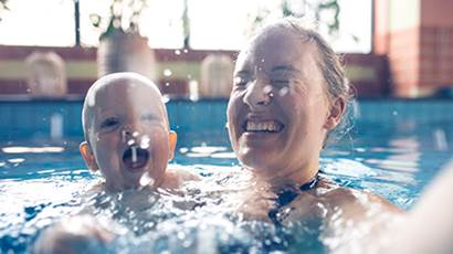 Mom and baby swimming in pool