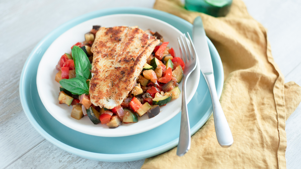 A basa fillet on top of a bed of ratatouille
