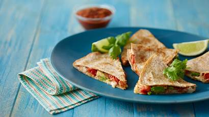 Chicken and avocado quesadillas on a blue plate