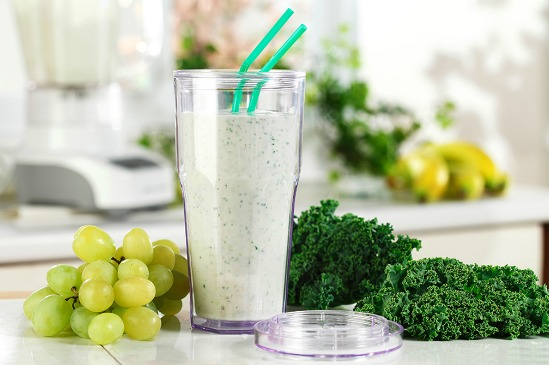 Powerhouse greenhouse smoothie in glass with green straw