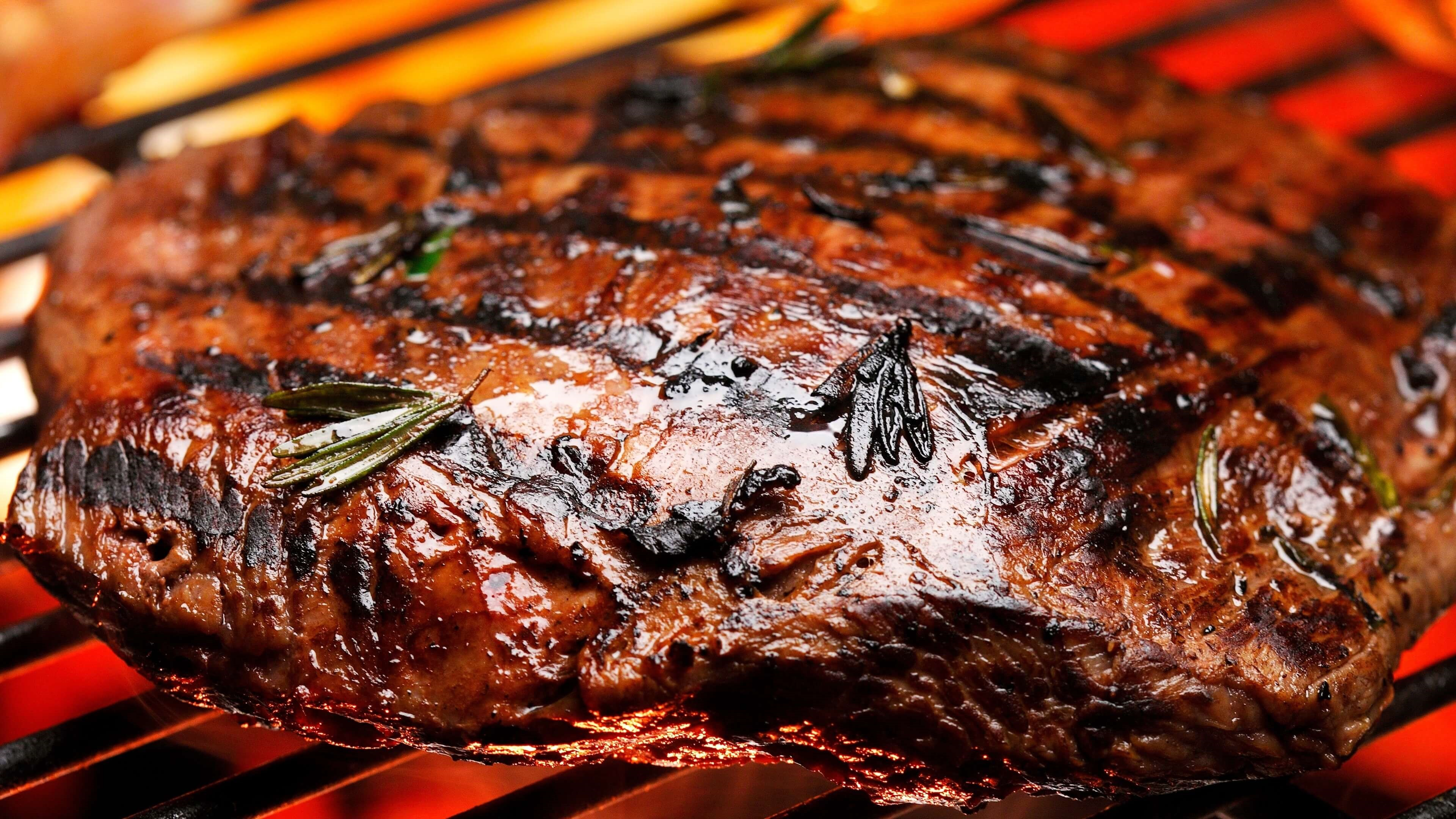 Grilled steak on barbeque