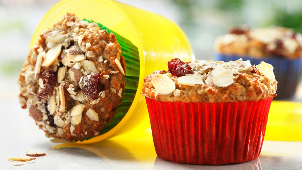 Muesli muffins with almonds and cranberries on kitchen counter