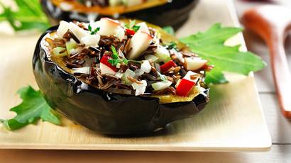 Two Wild rice and apple stuffed acorn squash halves
