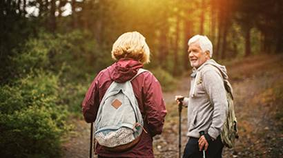 Senior couple hiking in the forrest
