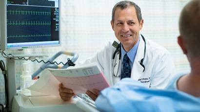 Researcher/Doctor talking to a patient and smiling
