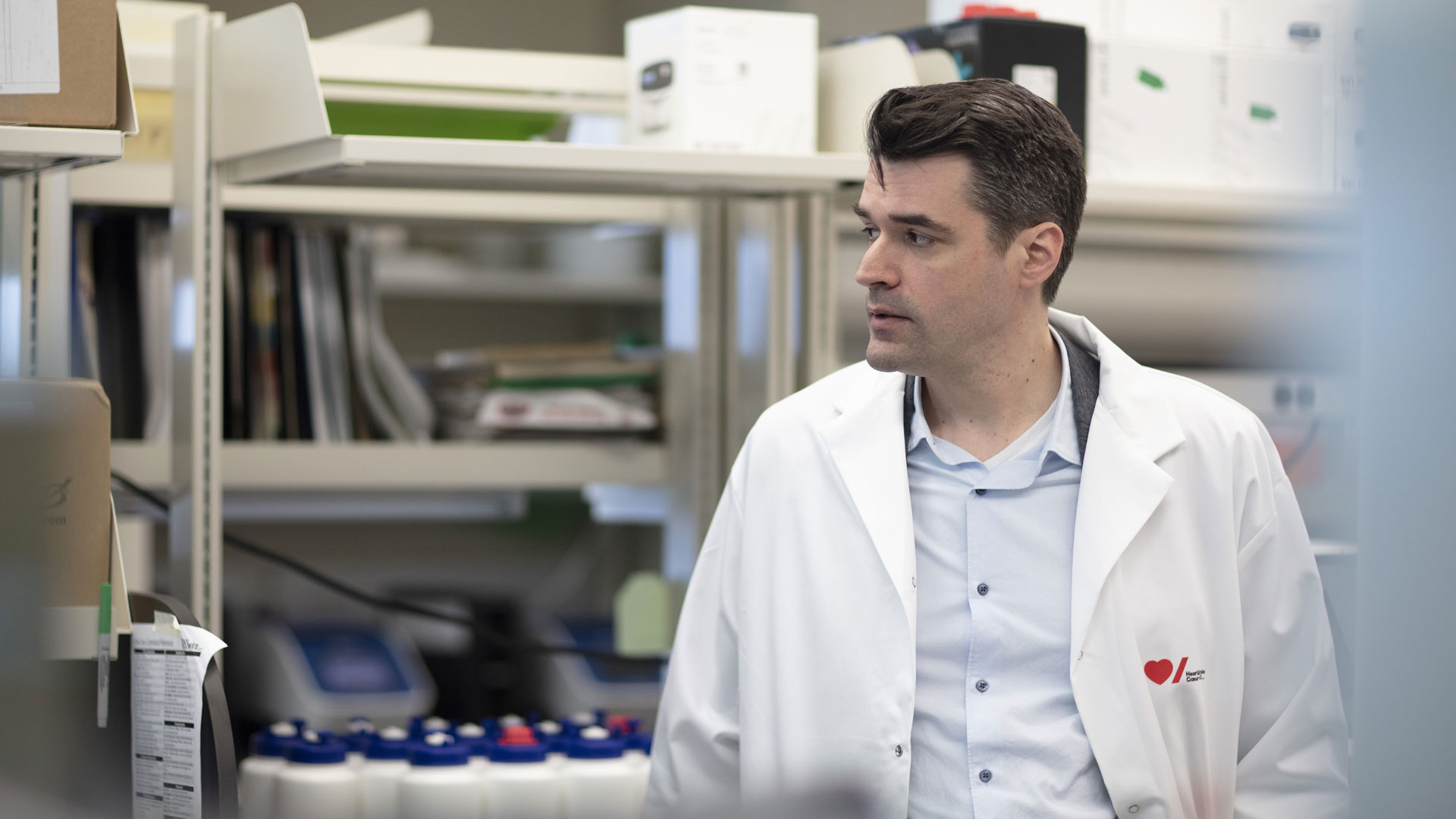 Dr. Guillaume Paré speaks with a colleague in his lab