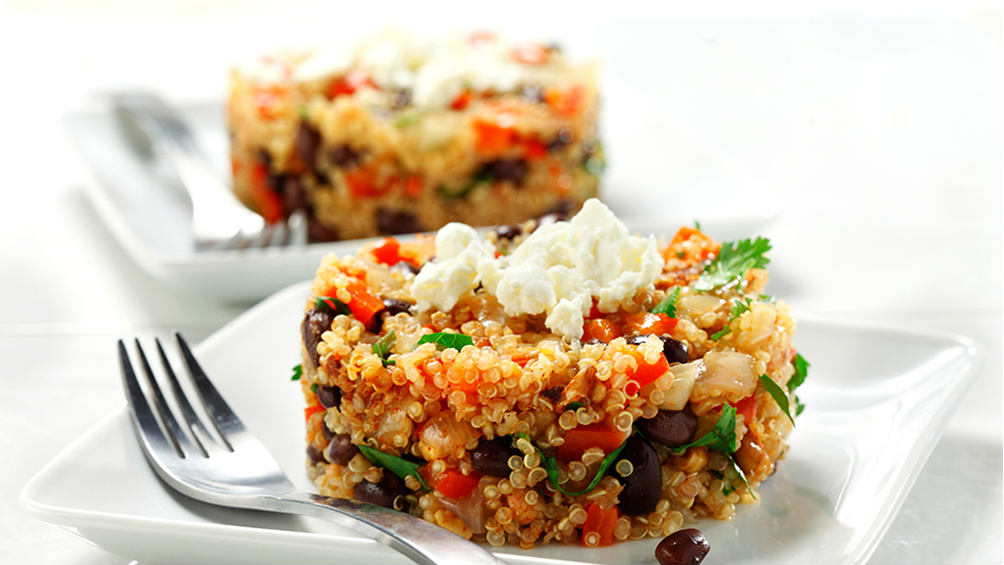 skillet quinoa with black beans on a white plate