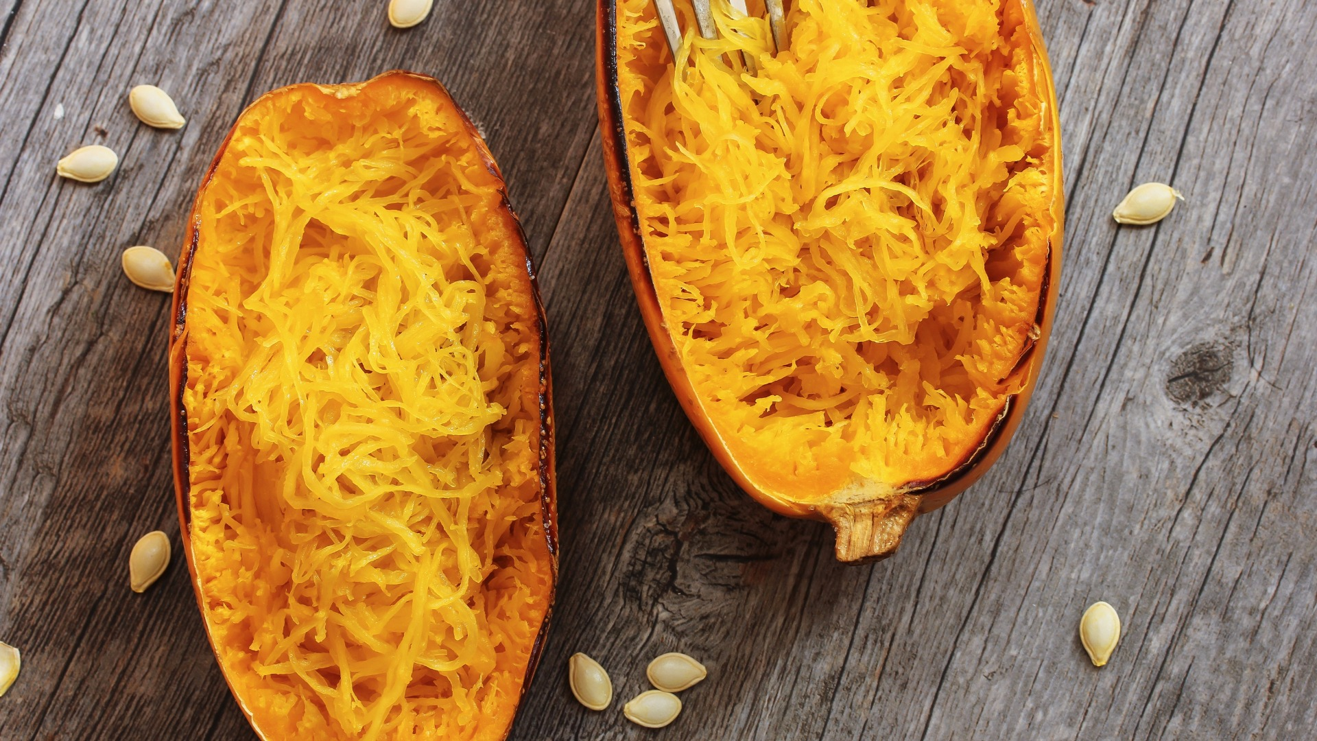 spaghetti squash on a wood table
