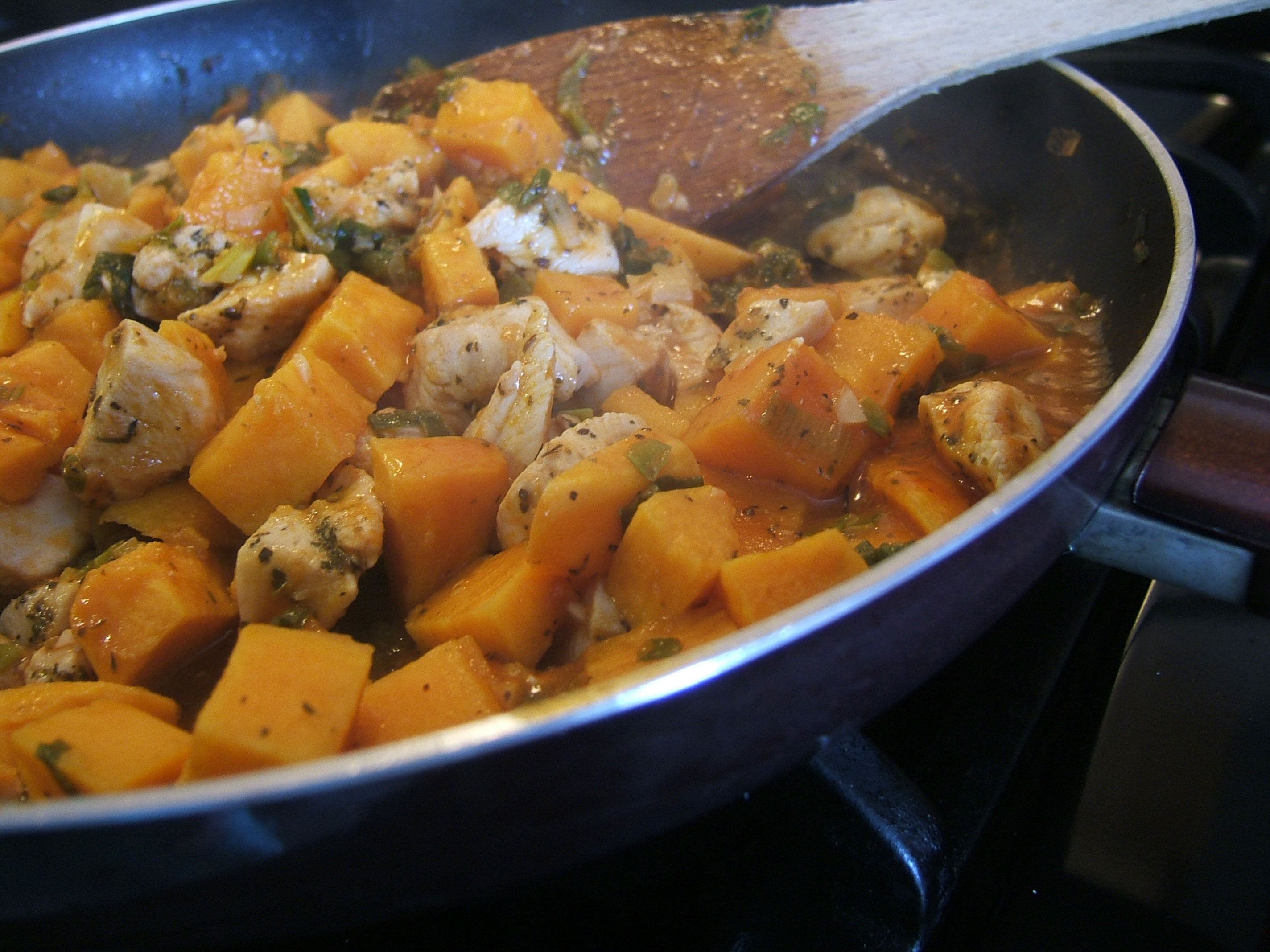 sweet potatoes sauteing in a skillet