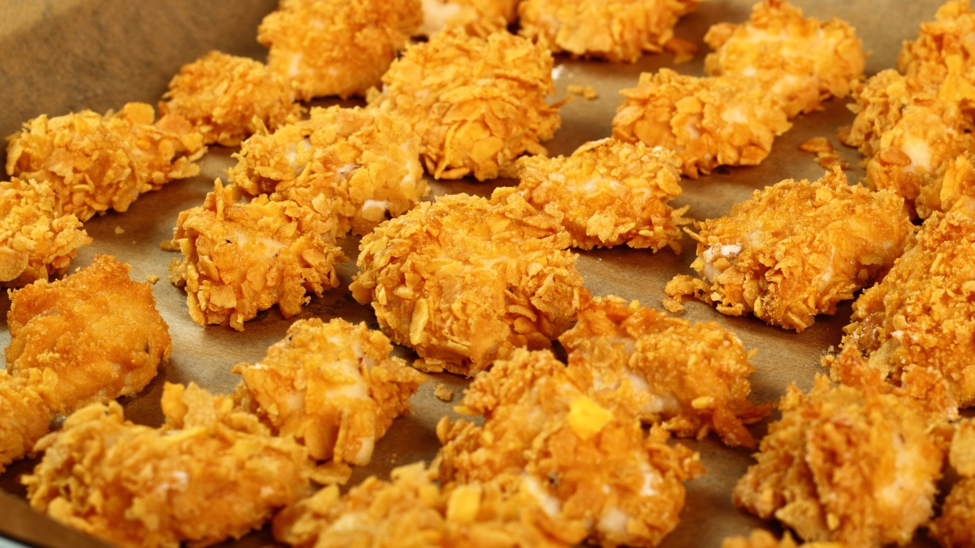 crunchy chicken pieces on a baking sheet