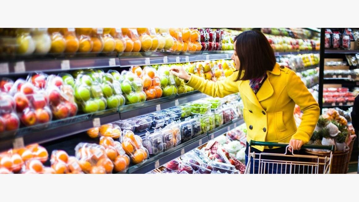 Woman shopping for fruit in grocery store