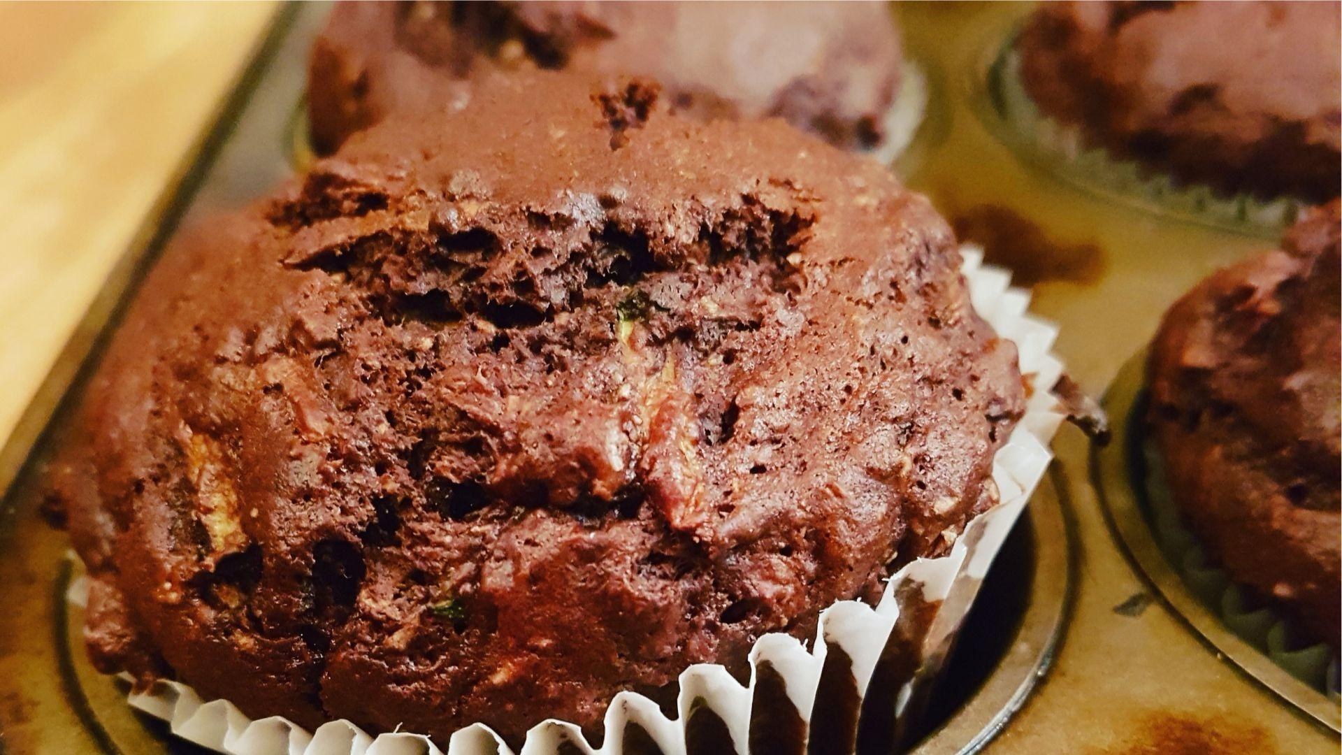 chocolate zucchini muffin in muffin tin