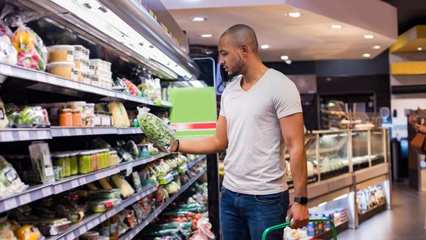A man shops at a supermarket.