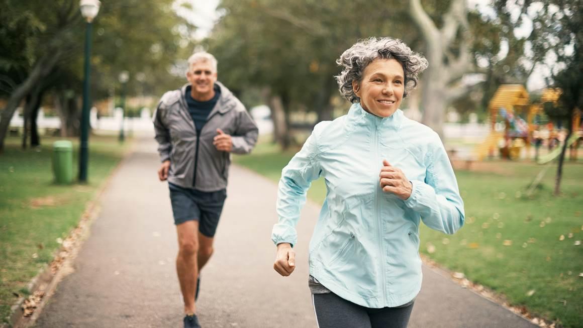 Older couple running together