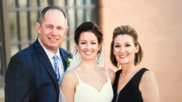 <p>Paul and Penny with their daughter Karli at her wedding.</p>
