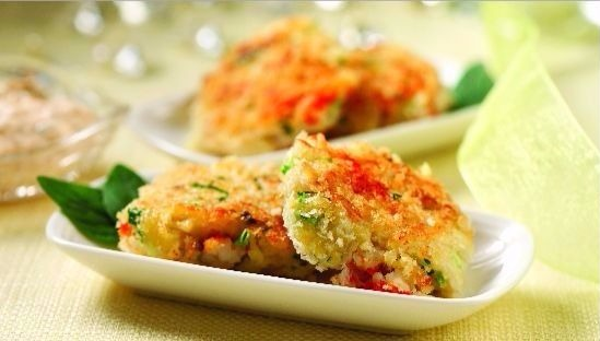 Two crab cakes on a white plate