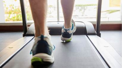 Close up of man's feet running on treadmill